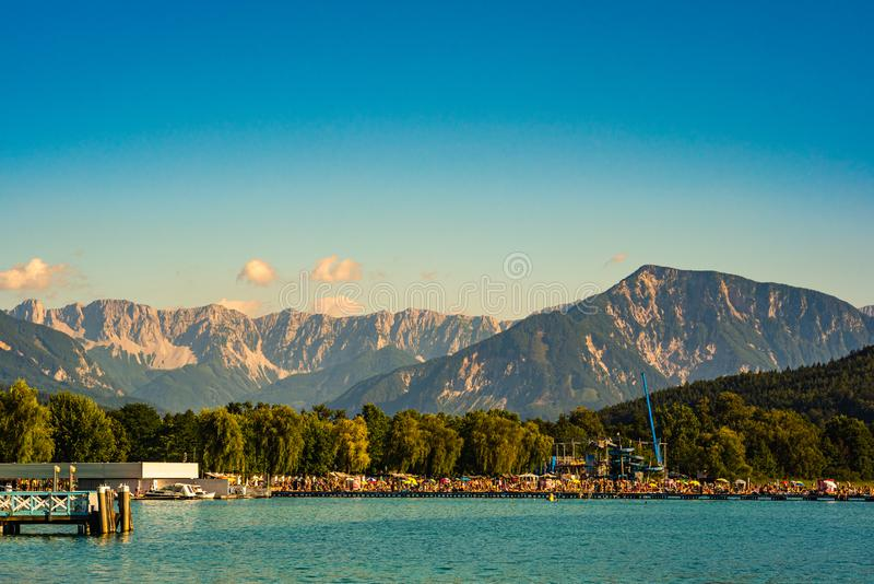 Klagenfurt, Austria 08.08.2016: Great lake Klagenfurt am Worthersee. The large lake of Klagenfurt in Austria. Many boats. Are anchored. Summer holiday resort royalty free stock images