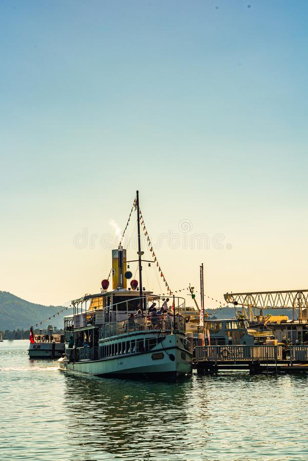 Klagenfurt, Austria 08.08.2016: Great lake Klagenfurt am Worthersee. The large lake of Klagenfurt in Austria. Many boats are. Anchored. Summer holiday resort of royalty free stock photography