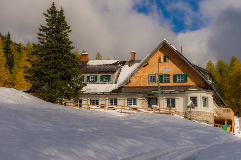 Klagenfurter Hütte, a mountain hut in the Karawanks. Feistritz, Austria - October 23rd, 2016: The Klagenfurter Hütte at early winter snowfalls is a