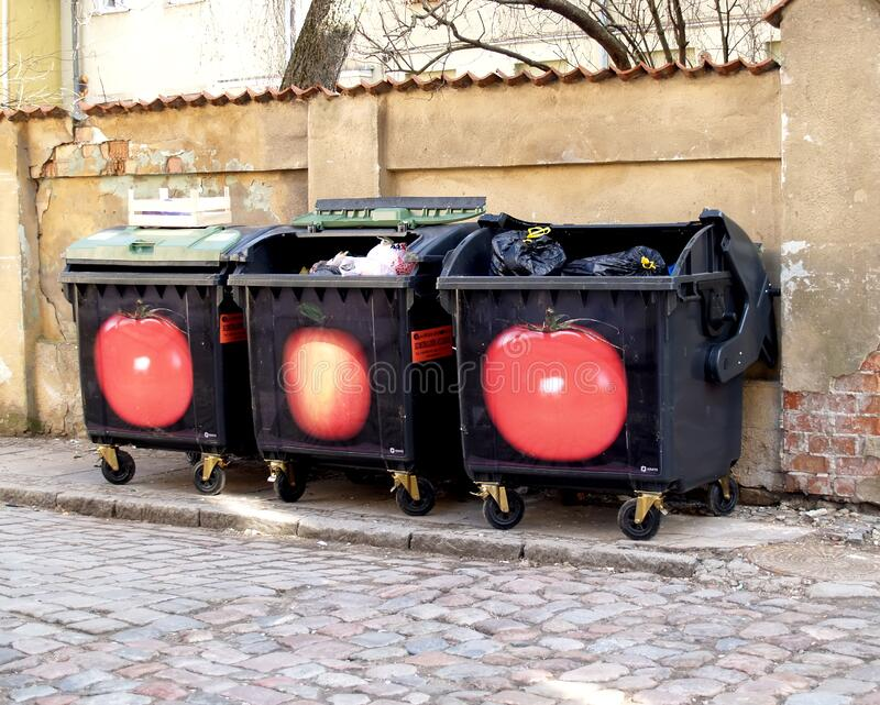 KLAIPEDA, LITHUANIA. Garbage containers on the city street. KLAIPEDA, LITHUANIA - MARCH 14, 2012: Garbage containers on the city street stock image