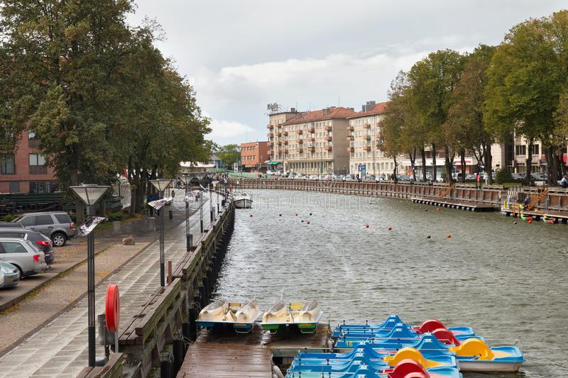 KLAIPEDA, LITHUANIA - SEPTEMBER 22, 2018: Panorama of the Dane river and town embankment in center part of the Klaipeda. royalty free stock images