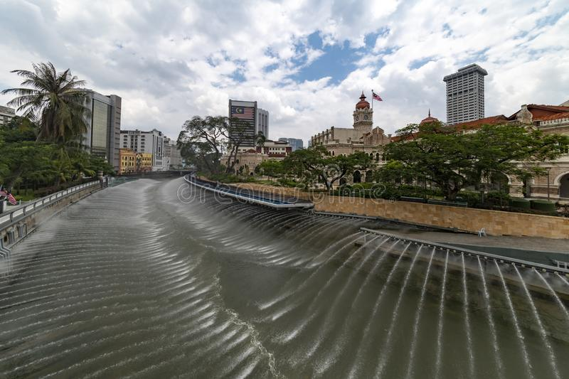 Klang river in Kuala Lumpur. Horizontal fountain water jets, on the Klang river in Kuala Lumpur, in front the Sultan Abdul Samad Building and in front the famous stock photo