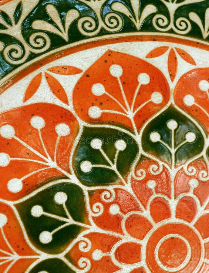 Klare orange und dunkelgrüne farbige gemalte Steintischplatte stockbilder