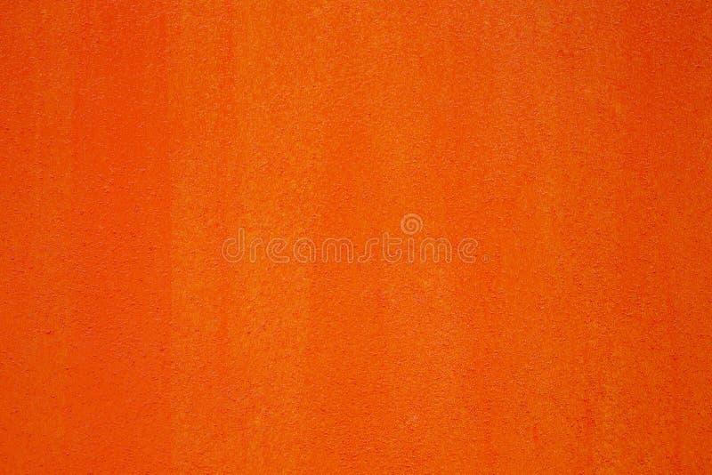 Klarer orange Wandbeschaffenheitshintergrund, abstrakte orange Zementwandbeschaffenheit und -hintergrund, Kopienraum und Hintergr lizenzfreie stockbilder