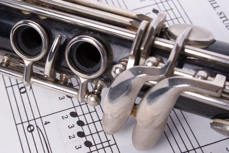 Klarinet en muziek stock fotografie
