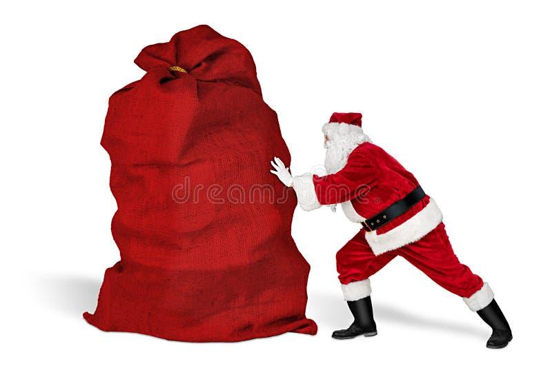 Klassiek, traditioneel gekkenwerk, grappige santa claus over het uitputten van de bezorgdienst grote rode tas met kerstcadeau stock afbeeldingen
