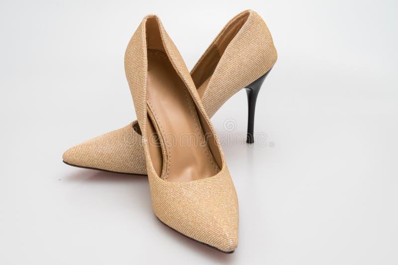 Klassische Schuhe der Stiletthohen absätze in der goldenen Beschaffenheit entwerfen lizenzfreie stockbilder