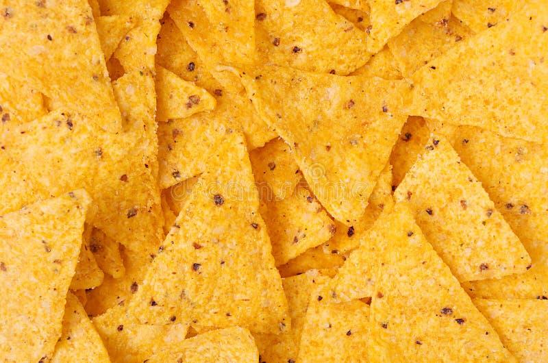Klassiskt mexikanskt mellanmål - nachos bakgrund, bästa sikt royaltyfria bilder
