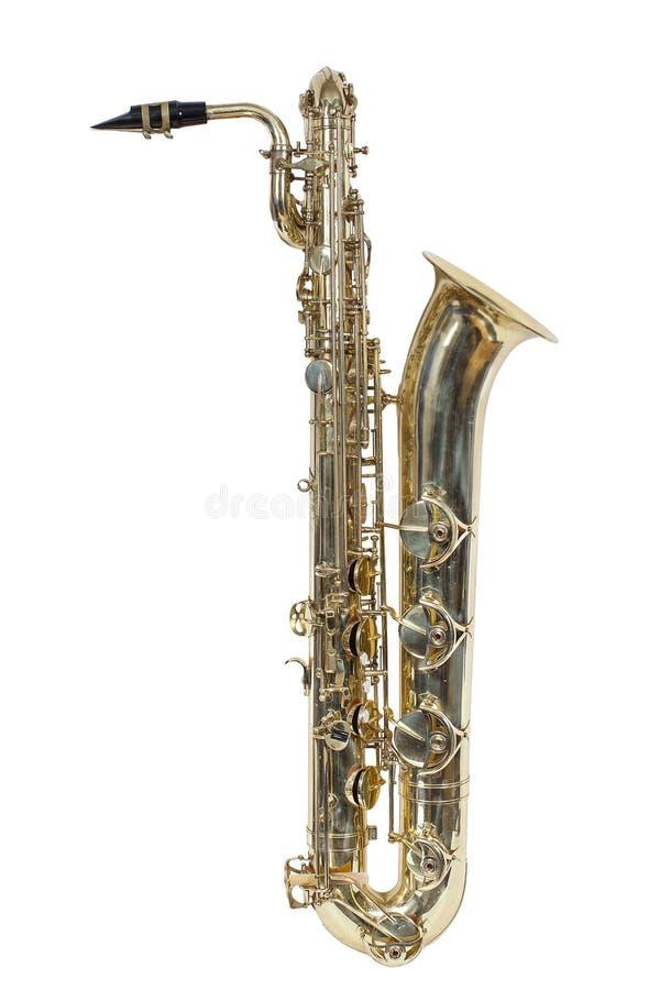 Klassiskt musikinstrument, den baryton- saxofonen som isoleras på vit bakgrund arkivbild