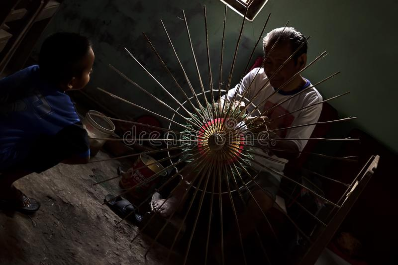 Klaten Indonesia. 15 June 2015. Activities of traditional umbrella makers from Juwiring Klaten Indonesia. The beautiful Klaten umbrella craft is known as the stock photography