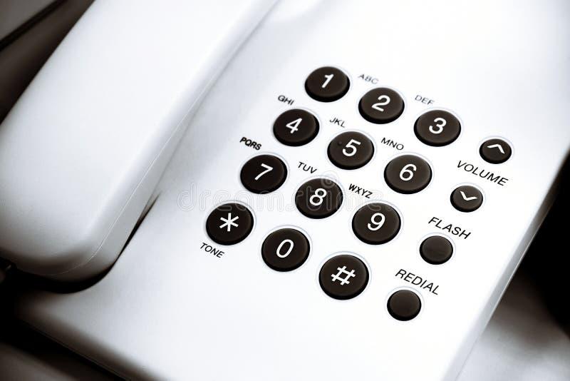 Klawiatura dla telephonic komunikacji lub niskiego k?ta widoku bia?a biurowa tarcza w g?r? kabla naziemnego zdjęcia stock