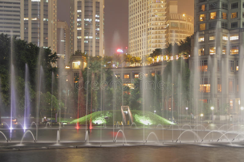 KLCC Fountains. Water fountains show at night in front of Malaysia s tallest building, Kuala Lumpur City Center, KLCC stock images
