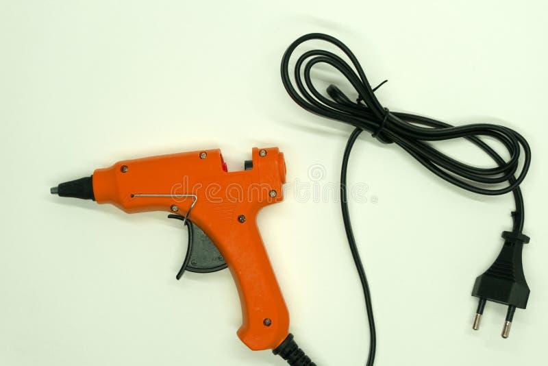 Klebriges Werkzeugweiß des Heißklebepistolestockes stockbild