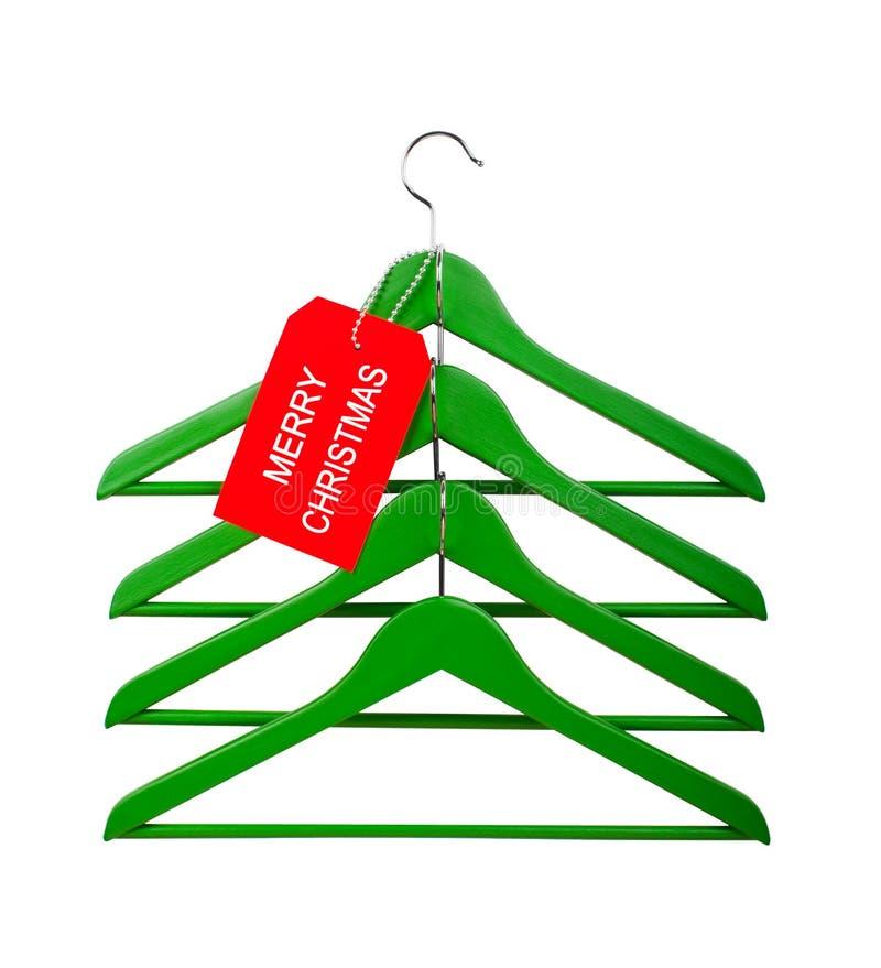 Kleerhangers in de vorm van een Kerstboom stock fotografie