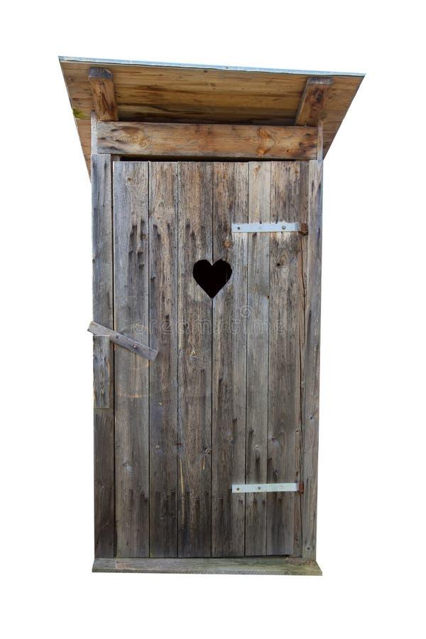 Klein houten die in openlucht toilet op wit wordt geïsoleerd royalty-vrije stock foto