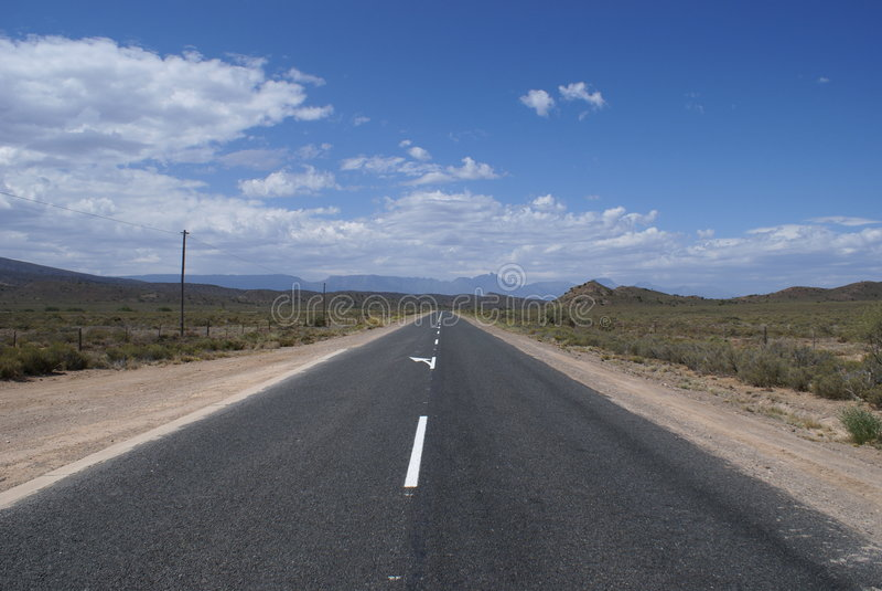 Klein Karoo. Straight road (route 62) in the Little Karoo (Klein Karoo) desert in South Africa stock photos