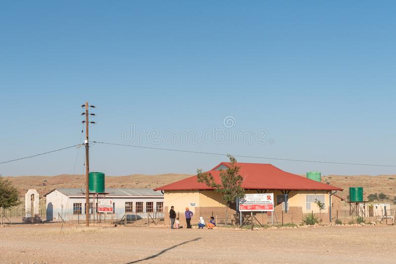 Primary health care clinic and a church in Klein Mier royalty free stock photos