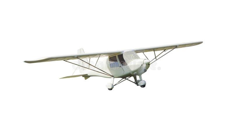 Klein uitstekend die vliegtuig op wit wordt geïsoleerd stock fotografie