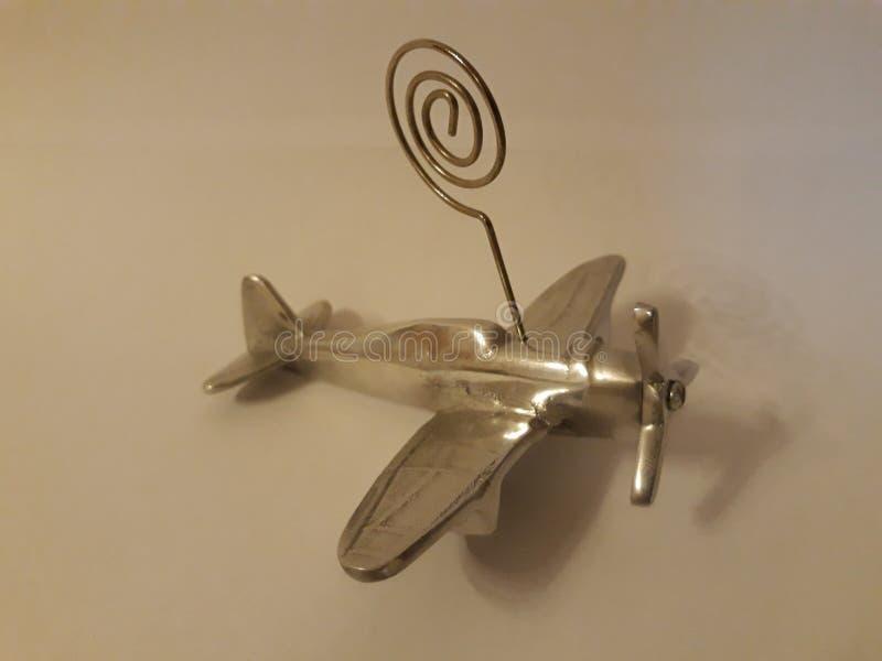 Klein vliegtuigornament voor schroot in verchroomd metaal stock foto