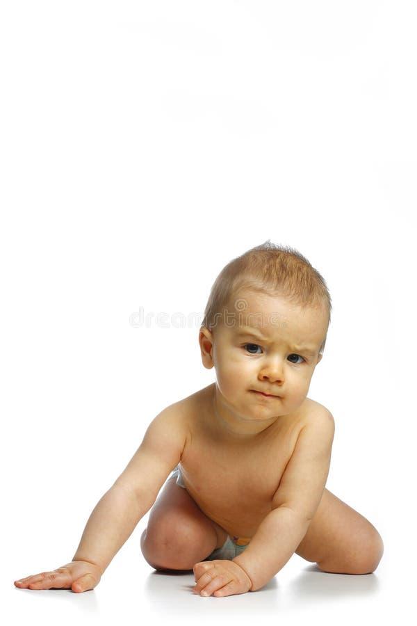 Kleine baby op de knieën stock afbeelding