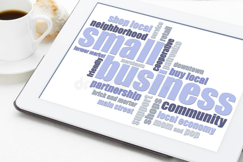 Kleine bedrijfswoordwolk op tablet stock foto