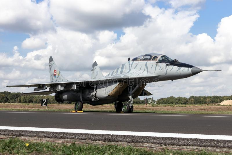 Lovak Air Force MiG-29 Fulcrum fighter jet plane. KLEINE BROGEL, BELGIUM - SEP 8, 2018: Slovak Air Force MiG-29 Fulcrum fighter jet aircraft on the tarmac of royalty free stock photo