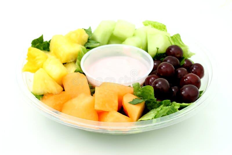 Kleine Frucht-Tellersegment Und Joghurt Lizenzfreie Stockfotos