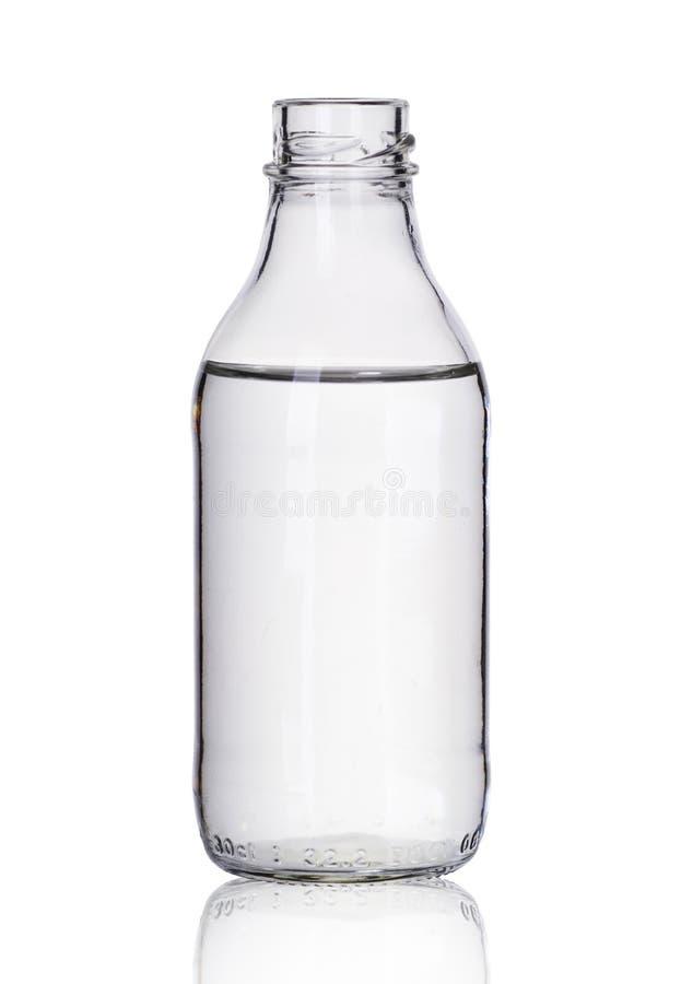 Kleine glasfles met vloeistof stock afbeelding