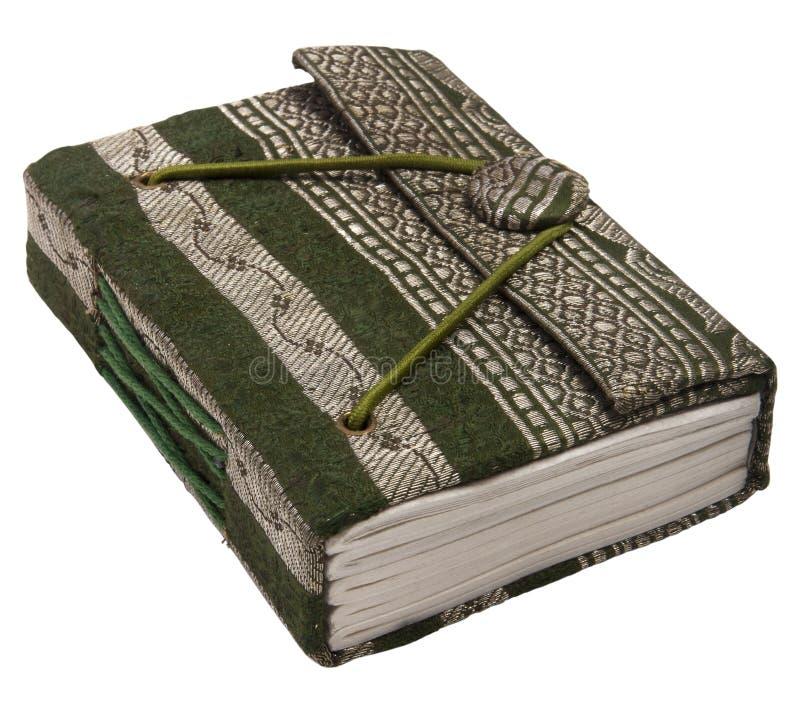 Kleine groene persoonlijke agenda met elastische sluiting Op witte achtergrond stock afbeelding