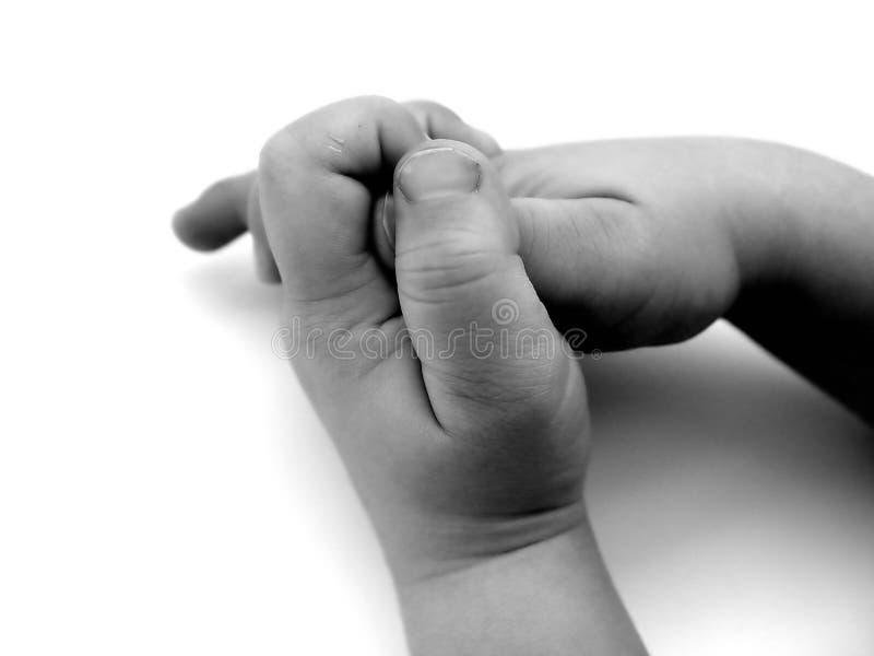 Kleine Hände stockbild