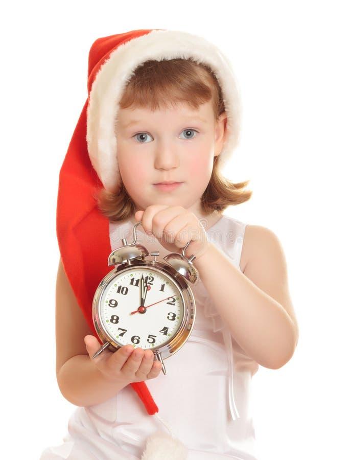 Kleine Kerstman met wekker stock fotografie