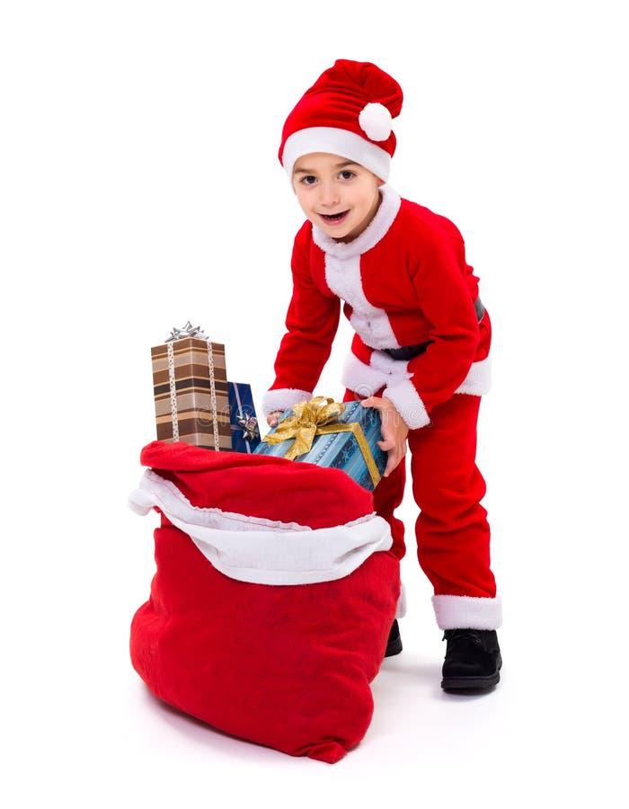 Kleine Kerstmanjongen met giftzak royalty-vrije stock afbeelding