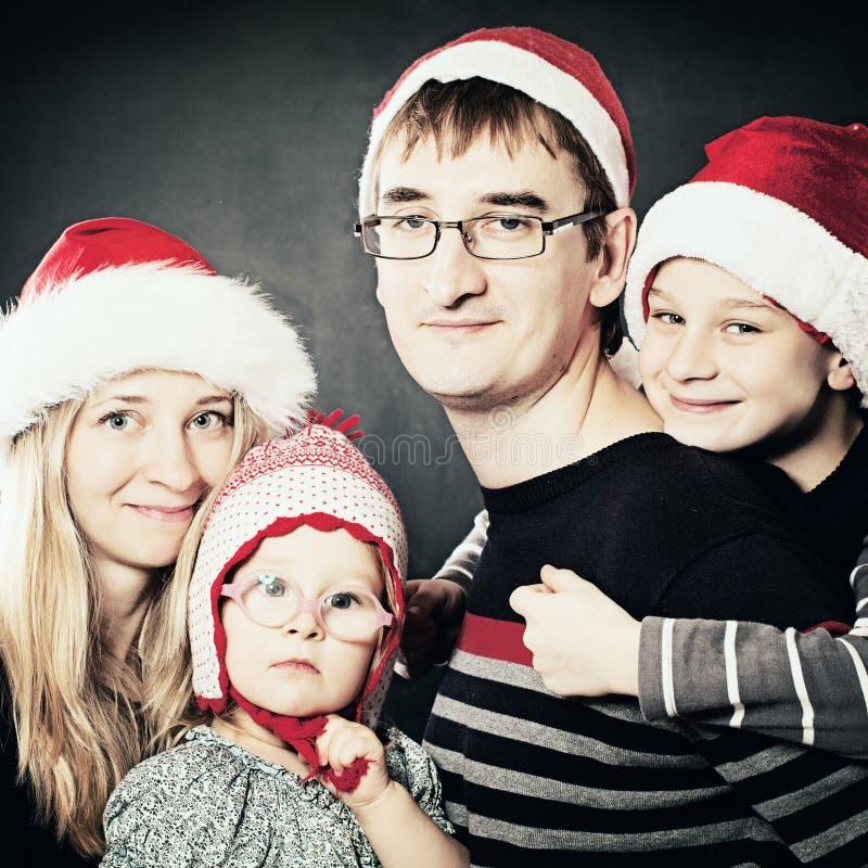 Kleine Kinderen, Moeder en Vader Kerstmis Family stock foto's