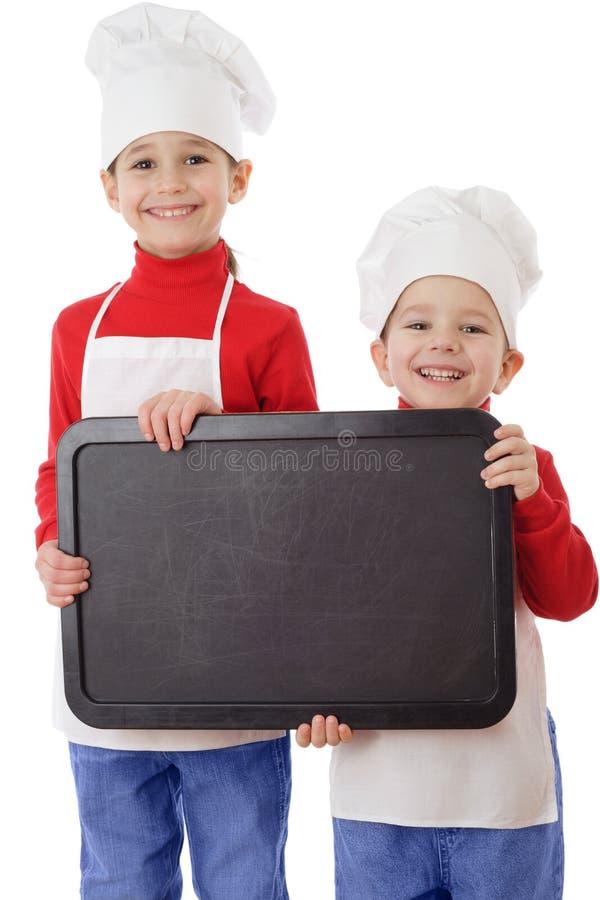 Kleine kooktoestellen met leeg horizontaal bord stock foto's