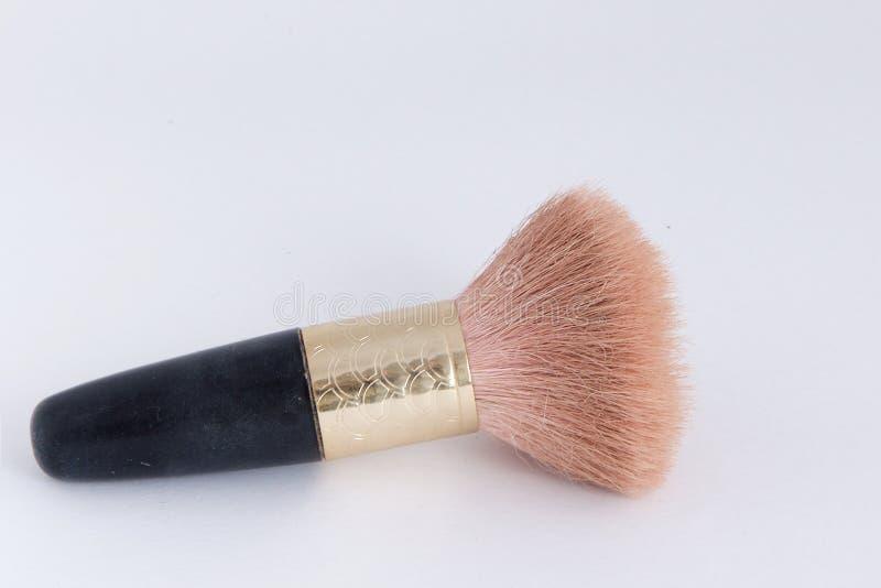 Kleine make-upborstel - het handvat is zwart met goud royalty-vrije stock foto