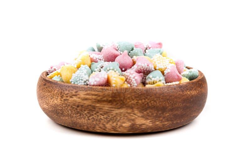 Kleine multicolored dalingen met de deklaagmunt van de suikerbal stock afbeelding