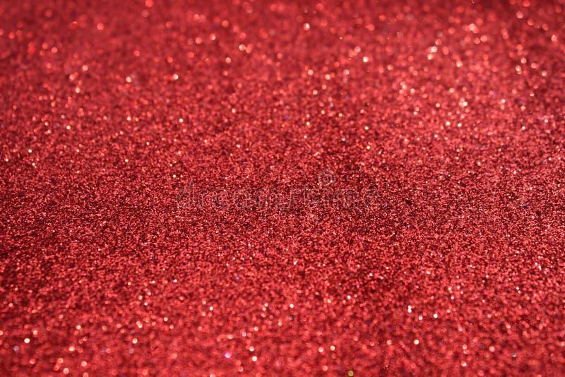 Kleine rode lovertjes als achtergrond Schitter als achtergrond van de vakantie Mooie rode achtergrond royalty-vrije stock fotografie