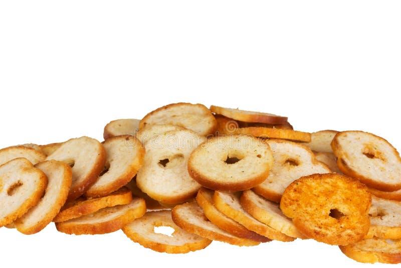 Kleine ronde mini bakt broodjes op een witte achtergrond royalty-vrije stock fotografie