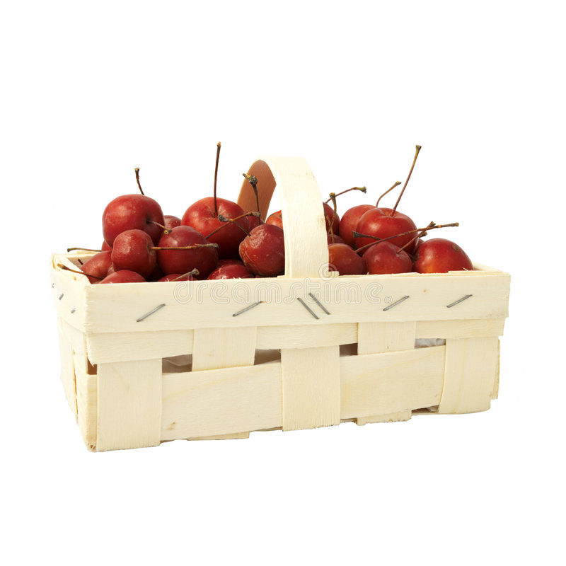 Kleine rote Äpfel in einem Korb lizenzfreie stockfotografie