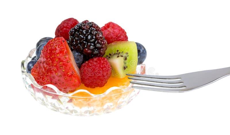 Kleine Schüssel Frucht mit einer Gabel stockfoto