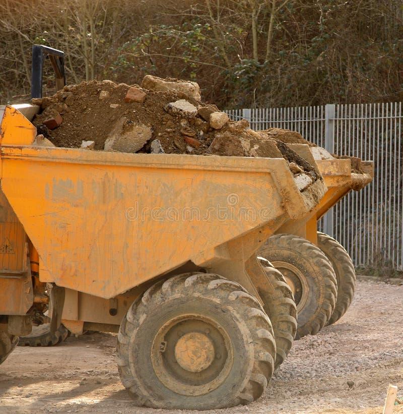 Kleine stortplaatsvrachtwagens royalty-vrije stock foto