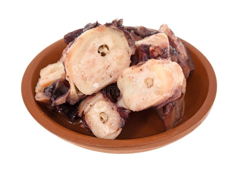 Kleine Umhüllung der gekochten Krake in der Knoblauchsoße stockfotos