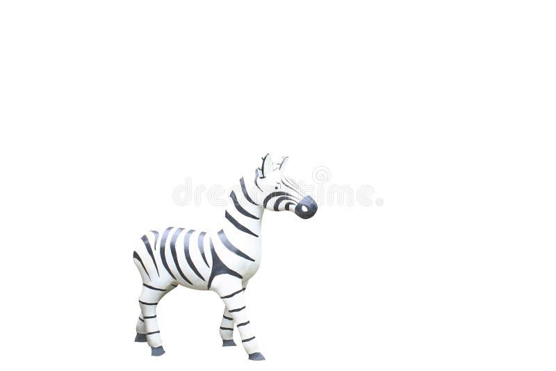 Kleine Zebrastatue lokalisiert auf weißem Hintergrund lizenzfreie stockfotografie