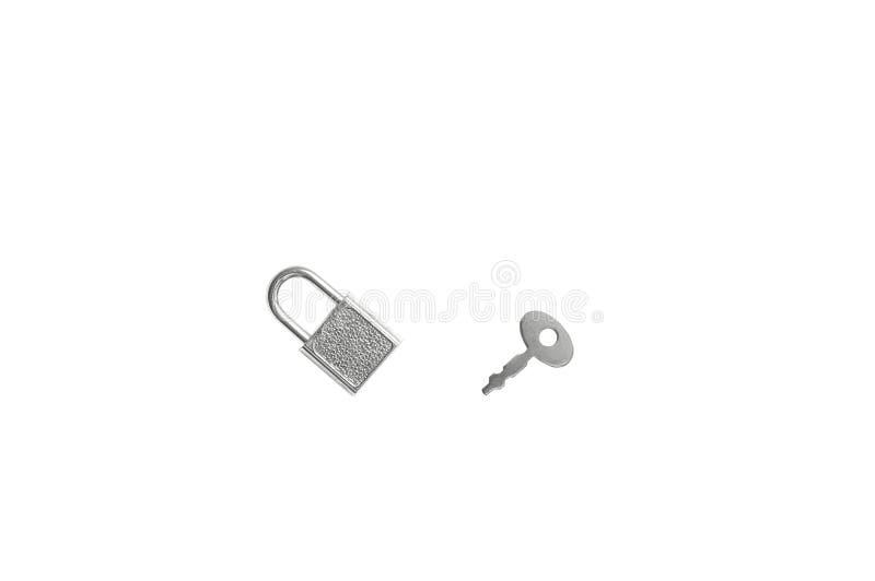 Kleine zilveren hangslot en sleutel stock fotografie