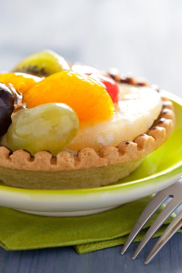 Kleine zoete fruitcake stock afbeelding