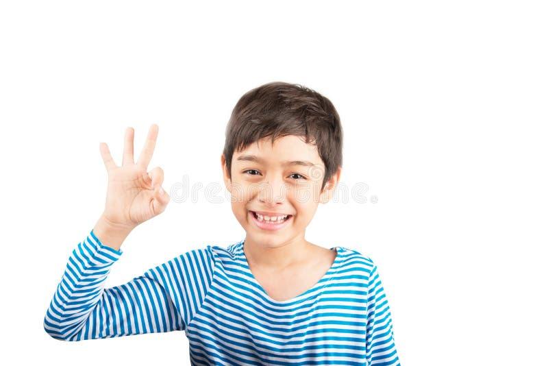 Kleiner Junge, der Hando.k.abschluß hohes Haltungsisolat zeigt stockfoto