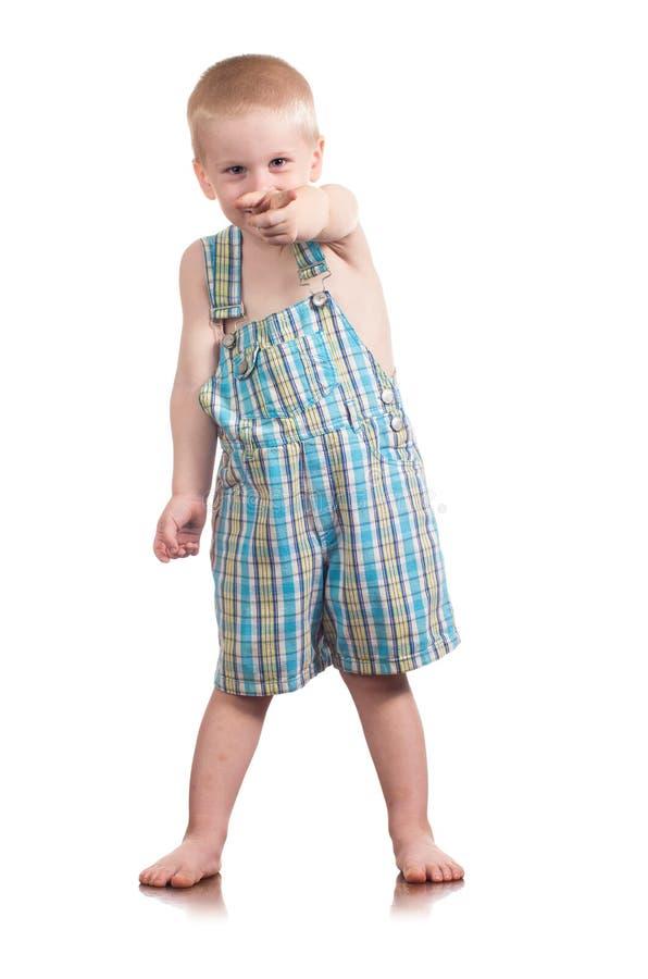 Kleiner Junge des kleinen Jungen, der auf Sie zeigt. stockbild