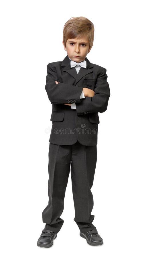 Kleiner Junge in einem Smoking stockfotos
