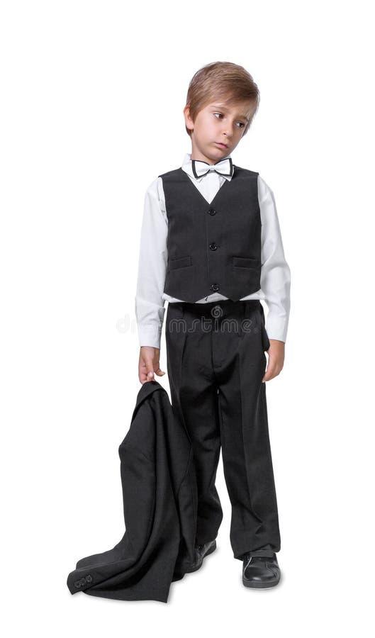 Kleiner Junge in einem Smoking stockfoto