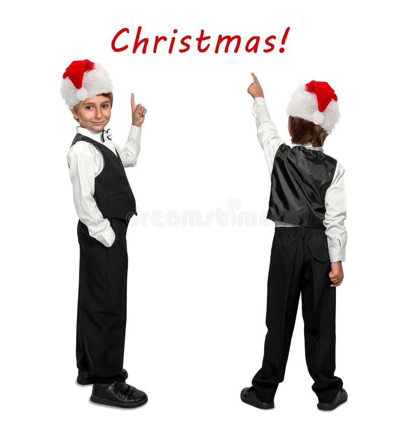 Kleiner Junge in einem Smoking und in Santa Claus-Weihnachtsrot stockfotografie